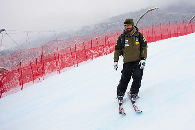 KITZBUHEL, AUSTRIA - JANUARY 25: Former ski racer and now speed team coach TJ Lanning glances over to the netting where he crashed 3 years ago during the pre race course inspection prior to the Audi FIS Alpine Ski World Cup SuperG on January 25, 2013 in Kitzbuhel, Austria, (Photo by Mitchell Gunn/ESPA) Image may be used for editorial use only.
